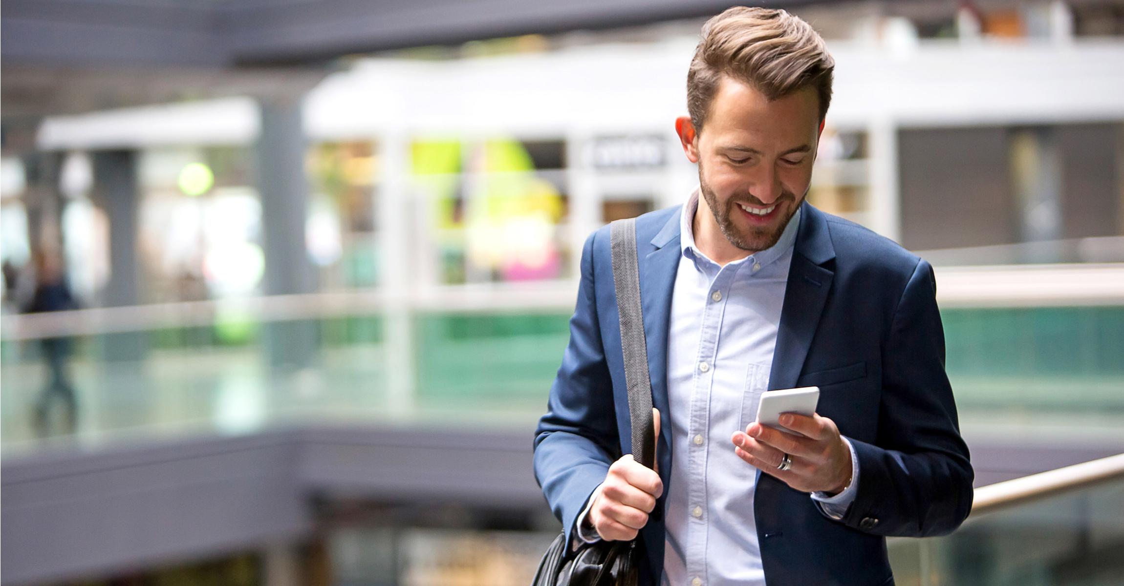 MAN_USING_MOBILE_PHONE