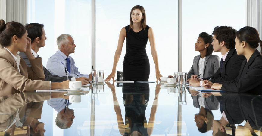 CEO and team around board table