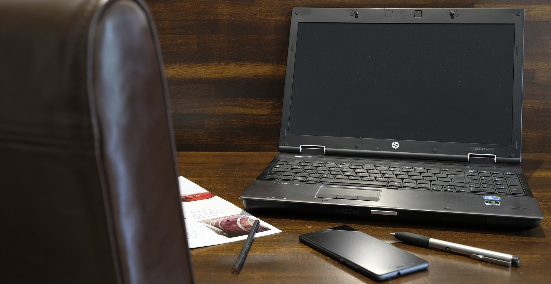 laptop and mobile phone on a desk